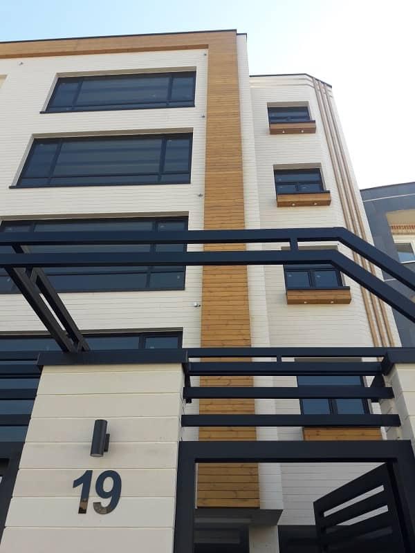 نمای ساختمان کار شده با ترمو چوب توسط شرکت چوب و چکش